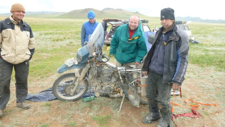Day 63 The Czech who is the mechanic of the crew and me spend the next three hours working on the bike. Despite no common language we respect and understand each other's ability and work well together.
