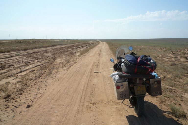 Day 28 He indicates this is the right road but that it will turn to dirt. He is right but at least its level dirt.