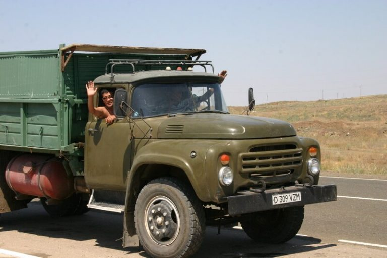 Day 35 We are joined by 2 drunken guys who stop their Old Russian truck to come and say hello. They shake hands and pose for photos. Shirtless and gold toothed they breath there alcohol breath through their smiles.