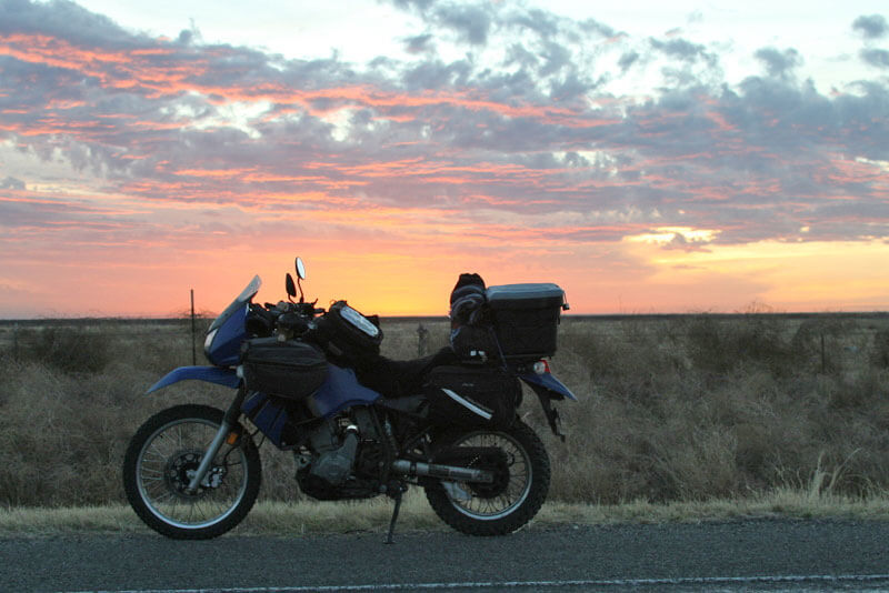Day 2 With a blood red sunset, the temperature rises and I cross into Texas. I can switch off my waistcoat.